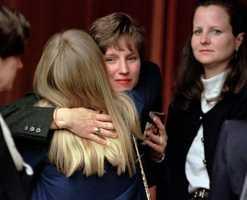 Supporters hug Deborah Eappen, the baby's mother.