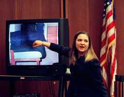 Woodward points to the bed which she layed infant Matthew Eappen on during her testimony at the Middlesex Superior Court in Cambridge, Mass., Monday Oct. 27, 1997.