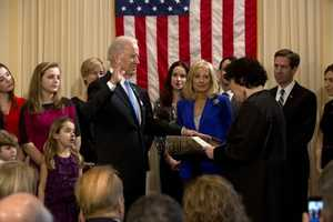 Supreme Court Justice Sonya Sotomayor administers the oath of office to Vice President Joe Biden during the official swearing-in ceremony at the Naval Observatory Residence in Washington, D.C., Jan. 20, 2013. Dr. Jill Biden, holding the Biden family Bible, and members of the Biden family surround the Vice President.
