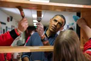 President Barack Obama stains shelves during a National Day of Service school improvement project at Burrville Elementary School in Washington, D.C., Saturday, Jan. 19, 2013. The First Family kicked off events for the 57th Presidential Inauguration by joining in the National Day of Service.