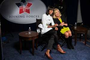 First Lady Michelle Obama and Dr. Jill Biden are interviewed prior to the Kids' Inaugural Concert at the Walter E. Washington Convention Center in Washington, D.C., Saturday, Jan. 19, 2013.
