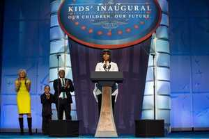 First Lady Michelle Obama delivers remarks during the Kids' Inaugural Concert at the Walter E. Washington Convention Center in Washington, D.C., Saturday, Jan. 19, 2013. Joining Mrs. Obama on stage, from left, are Dr. Jill Biden, Jaelen Franco, and J.R. Martinez.