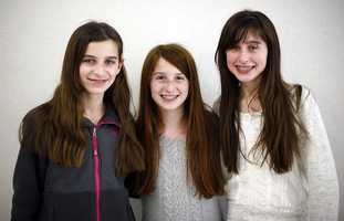 Seeing triple? Grace, Alexis and Madison Monti are the only set of triplets among the  16 other sets of twin siblings in Pembroke Community Middle School's 7th grade class.