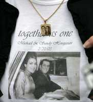 Claire Hoogasian displays outside Kent County Superior Court in Warwick, R.I., Sept. 29, 2006, a T-shirt and necklace honoring her son Michael and daughter-in-law Sandy Hoogasian, both who died in the 2003 fire at The Station nightclub. Claire Hoogasian attended court proceedings for Michael and Jeffrey Derderian.