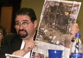 Raymond Mattera, father of Tammy Mattera-Housa, who died in The Station nightclub fire, holding a newspaper photo of the fire, pleads with the fire commission to change the fire laws Thursday, May 22, 2003.