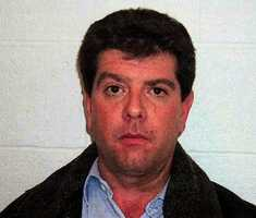 This is a police photo taken at the West Warwick, R.I. Police Station of The Station nightclub owner Michael Derderian taken Tuesday, Dec. 9, 2003. Derderian was arraigned on 200 counts of involuntary manslaughter stemming from the fire at The Station nightclub in West Warwick on Feb. 20, 2003, that killed 100 people.