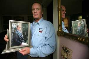 James Gahan is photographed, May 13, 2006, at his home in Falmouth, Mass., with a portrait of his son, Jimmy, who died in the Station Nightclub fire in 2003 in West Warwick, R.I. Gahan was one of those who made a statement in court this week when Dan Biechele was sentenced. He asked that the court have mercy on Biechele.