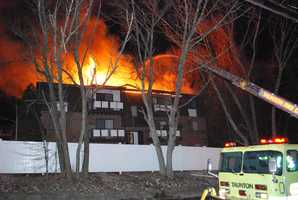 Fire ripped through a Taunton apartment complex Sunday night, displacing residents of dozens of units.