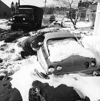 A National Guardsman checks a stranded car Feb. 9, 1978, in Hampton, N.H., after the Blizzard of '78 to see if anyone was trapped inside.