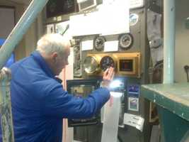 Bob Skilling reads a wind gauge at Blue Hills.