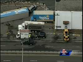 Strong winds appear to have flipped a moving truck over, along with causing the partial collapse of a building in Revere.