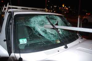 A Hanson couple is lucky to be alive after a bizarre crash drove a road sign through their windshield like a javelin.