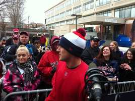 Boston Red Sox infielder Will Middlebrooks posing for photos with some of the fans.