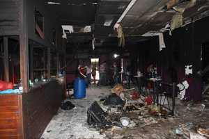 """""""It looked like a war zone,"""" Brazil state lawmaker Valderci Oliveira said on Jan. 29 about the nightclub fire in Santa Maria that killed 238."""