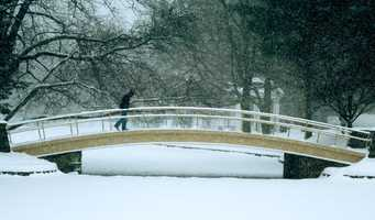 A student, head down to avoid wind-swept snow, makes his way across a foot bridge on the Wheaton College campus, in Norton, Mass., Feb. 17, 2003, during the storm.