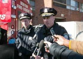 Boston Police Superintendent in Chief Dan Linskey briefs the media with Superintendent William Evans, at left, outside the Roslyn Apartments at 1 Cliffmont St in Roslindale after 2 residents died unexpectedly and a 3rd fell ill on Thursday.