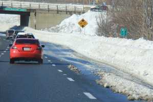 Even after the initial storm ended and snowplows had cleared main roads, they had to start working on the snow drifts, which blocked travel lanes on many Boston roadways. This was the expressway in Quincy.