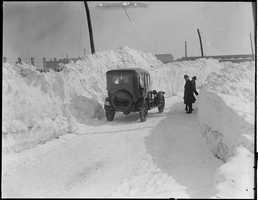 This vehicle along a road in Plymouth shows how high the snow drifts were following the storm.