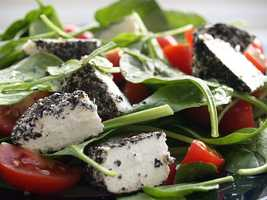 Spinach salad: 1 cup raw spinach leaves ½ cup tangerine sections ½ ounce chopped walnuts4 tsp oil and vinegar dressing