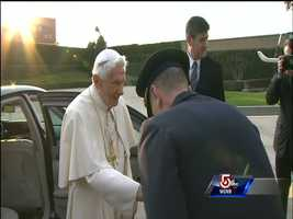 Benedict XVI greets folks outside the helicopter.