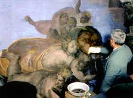 Chief restorer Gianluigi Colacucci is pictured while cleaning a portion of Michelangelo's Last Judgement in the Sistine Chapel on Nov. 22, 1993.