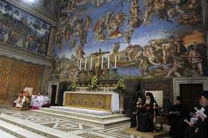 In this picture made available by the Vatican newspaper L'Osservatore Romano, the spiritual leader of the world's Orthodox Christians, patriarch Bartholomew, at far right seated, prays with Pope Benedict XVI, at far left, in the Sistine Chapel at the Vatican, Oct. 18, 2008.