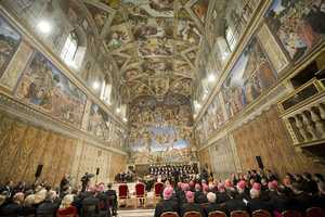 The Sistine Chapel is famous for its architecture and its decoration that was frescoed by Renaissance artists including Michelangelo.  In this photo, a concert is being held with Pope Benedict XVI in attendance on Dec. 4, 2009.