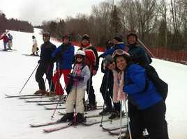 About 100 skiers joined SportsCenter 5's Mike Lynch Saturday on Loon Mountain for the 20th annual Briefcase Race.