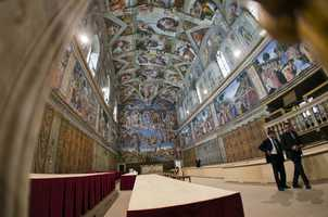 A view of the the Sistine's frescoed walls on March 9, 2013.  The Cardinals will sit at the long tables as they meet to elect the next pope.