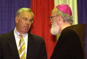 Tuesday, April 13, 2004: Boston Mayor Tom Menino speaks with O'Malley before the keynote session of the 101st Annual Convention and Exposition of the National Catholic Educational Association. O'Malley was the keynote speaker for the session.
