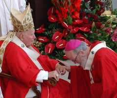 June 29, 2004: O'Malley pays homage to Pope John Paul II after receiving the pallium during an ancient rite. The pallium is a band of white wool decorated with black crosses that symbolizes the bond with the Vatican.