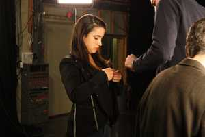 Raisman adjusts her microphone during the promo shoot.