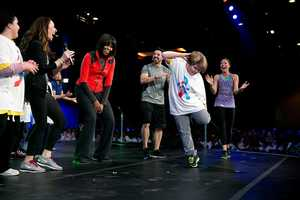 """First Lady Michelle Obama participates in a """"Let's Move! Active Schools"""" event with athletes and students at McCormick Place in Chicago, Ill., Feb. 28, 2013."""