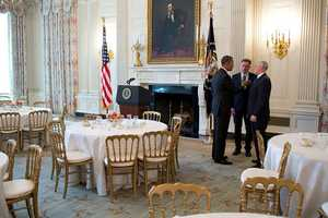 President Barack Obama talks with Gov. Peter Shumlin, D-Vt., center, chair of the Democratic Governors Association, and Gov. Mike Pence, R-Ind., after a meeting with the National Governors Association in the State Dining Room of the White House, Feb. 25, 2013.
