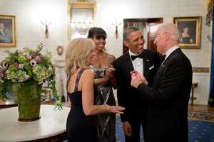 President Barack Obama and First Lady Michelle Obama talk with Vice President Joe Biden and Dr. Jill Biden in the Blue Room of the White House before the National Governors Association Dinner, Feb. 24, 2013.