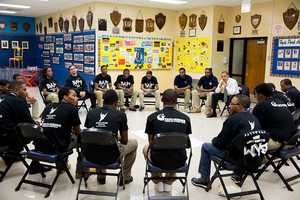 """President Barack Obama participates in a """"Becoming a Man"""" program roundtable at the Hyde Park Career Academy in Chicago, Ill., Feb. 15, 2013."""
