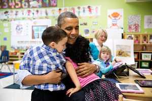 President Barack Obama hugs students during a visit to a pre-kindergarten classroom at the College Heights Early Childhood Learning Center in Decatur, Ga., Feb. 14, 2013.