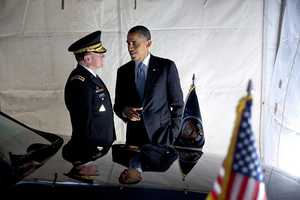 President Barack Obama talks with General Martin Dempsey, Chairman of the Joint Chiefs of Staff, after attending the Armed Forces farewell tribute for Defense Secretary Leon Panetta at Joint Base Myer-Henderson in Arlington, Va., Feb. 8, 2013.