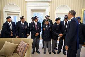 President Barack Obama greets veterans of the 2nd Ranger Infantry Company (Airborne) in the Oval Office, Feb. 27, 2013.