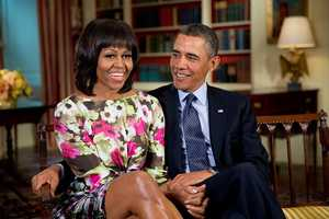 """President Barack Obama and First Lady Michelle Obama record a message for ABC """"Good Morning America"""" anchor Robin Roberts, in the Library of the White House, Feb. 19, 2013."""