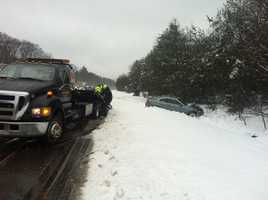 Several multi-car crashes, like this one on Route 128 south in Dedham, were reminders that the roads were still slick and drivers need to use caution.