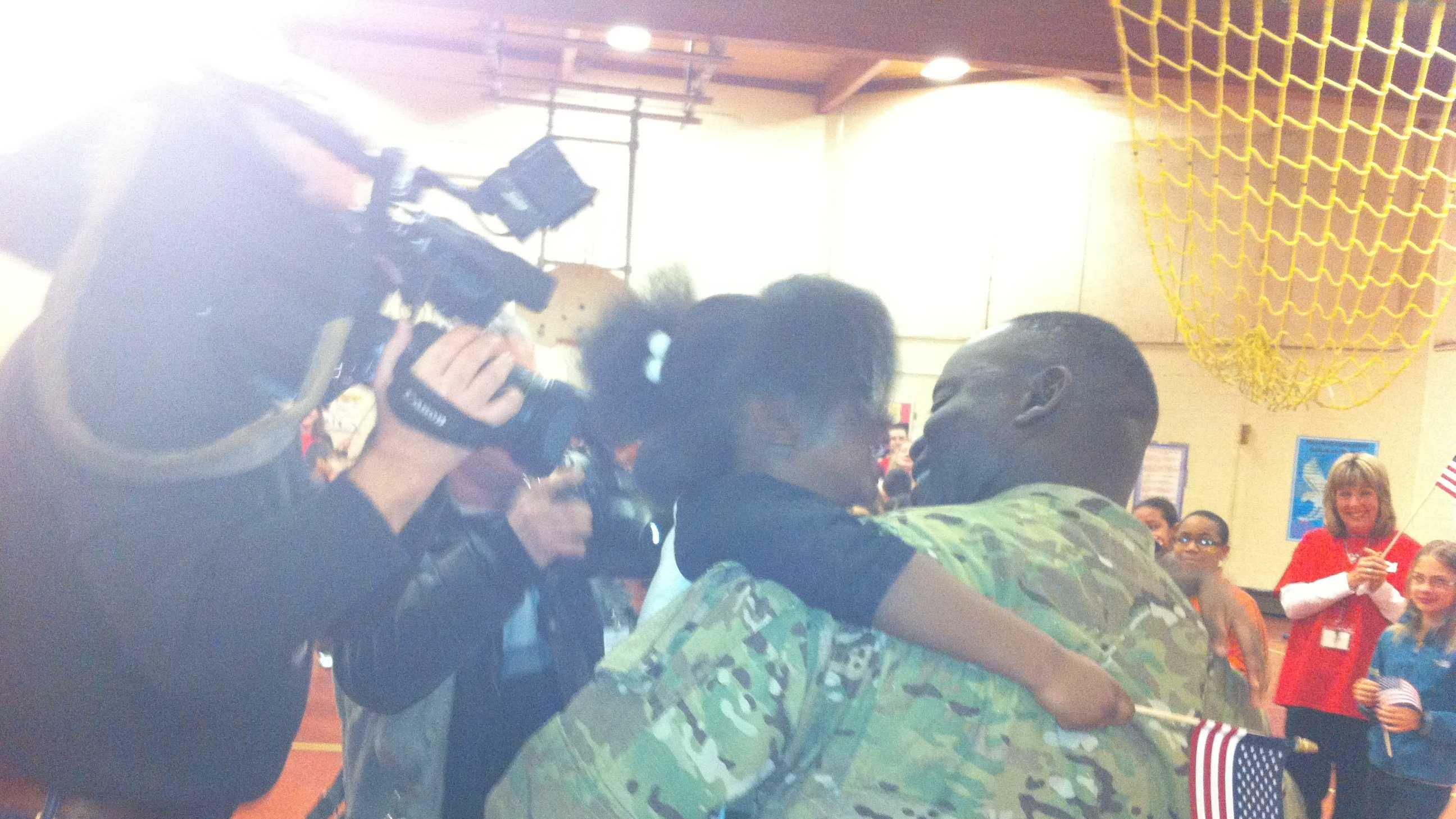 Soldier greets kids
