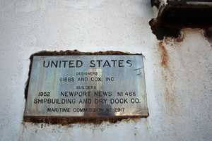 In this June 25, 2012 photo, rust collects around a plaque on the SS United states, in Philadelphia. Caretakers for the legendary ocean liner moored on the Delaware River since 1996, are renewing and expanding their distress call for the beleaguered piece of American maritime history.