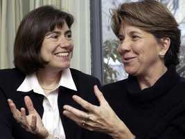 Hillary and Julie Goodridge laugh became the first same-sex couple to receive an application for a marriage license in Boston, May 17, 2004.