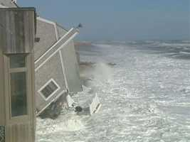 Homes are toppling into the ocean.
