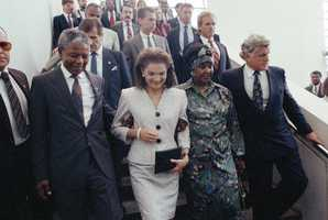 Jacqueline Kennedy Onassis escorts Nelson Mandela during Mandela's visit to the John F. Kennedy Library on June 23, 1990 in Boston.