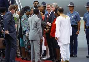 Nelson Mandela, left center, shakes hands with Sen. Edward Kennedy after Mandela's arrival at Logan International Airport,June 23, 1990. Boston Mayor Ray Flynn looks in between the two men. At far left in Mandela's wife Winnie with Massachusetts Gov. Michael Dukakis in background.