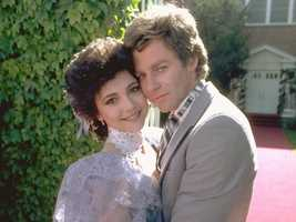 To prevent Holly from being deported, she and Robert wed in a quick legal ceremony at the mayor's office in 1983.
