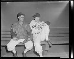 Boston Red Sox Bobby Doerr (L) and Mickey McDermott sitting in the dugout at Fenway Park in 1951.