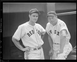 (L to R) Boston Red Sox Bobby Doerr and Jimmy Foxx in the dugout at Fenway Park in 1939.